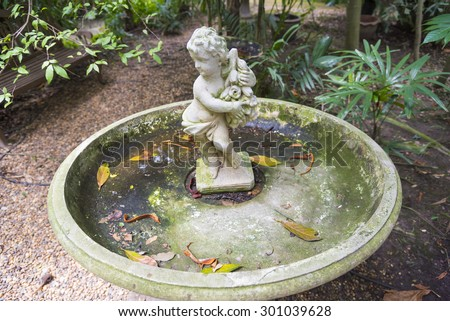 Cupid sculpture - stock photo