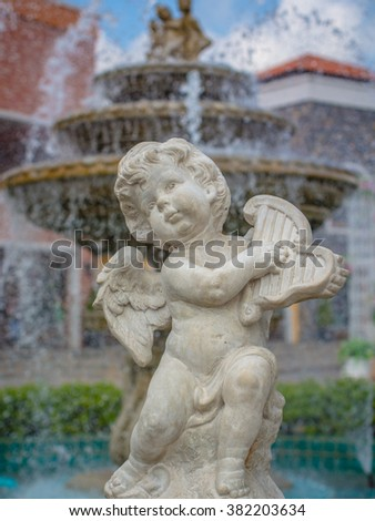 Cupid statue in garden