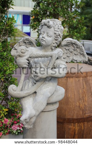 Cupid statue in Public garden - stock photo