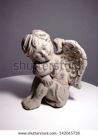 Cupid statue isolated