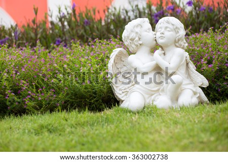 Cupid statue kiss - stock photo