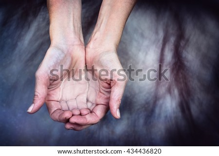 Cupped hands holding clear clean water - stock photo
