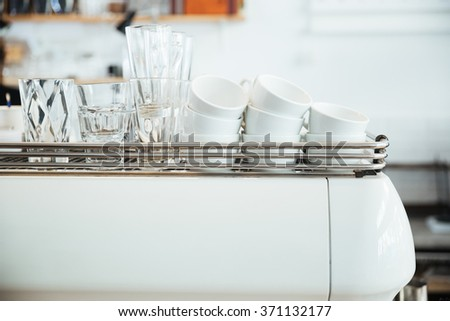 Cups and glasses on coffee machine