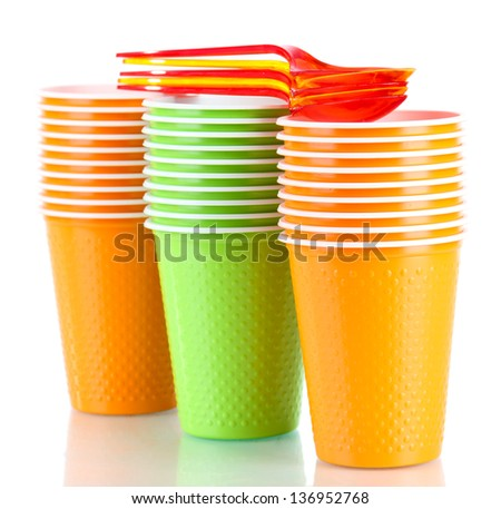 Cups and spoons in different color isolated on white - stock photo