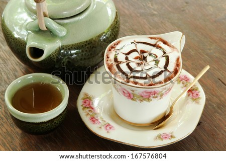 Cups of coffee and cup tea on the table - stock photo