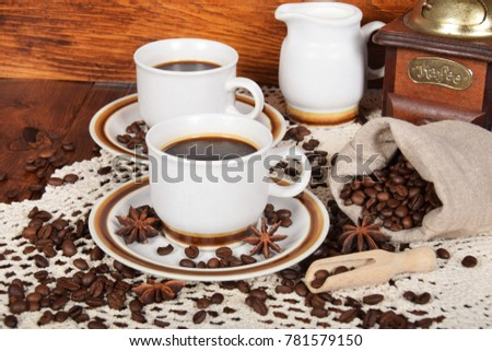 cups of coffee and milk and roasted coffee beans