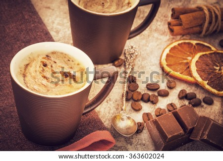 Cups of coffee on wooden