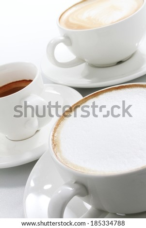cups of coffee varieties isolated on white - stock photo