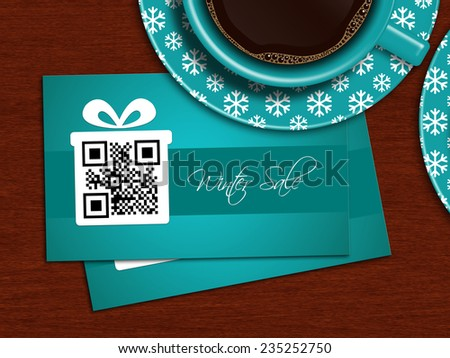 cups of coffee with winter sale coupons on  table - stock photo