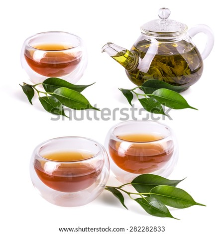 Cups of tea and teapt with fresh tea leaf on a white background