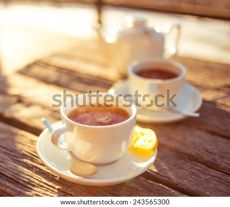 Cups of tea on a wooden table. Toned picture - stock photo