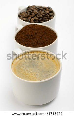 cups with coffee, beans and blend. closeup