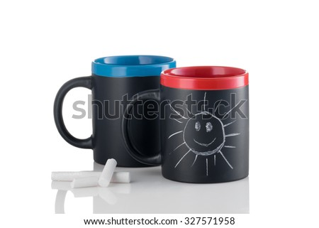 Cups with smiling sunshine made with chalk - stock photo