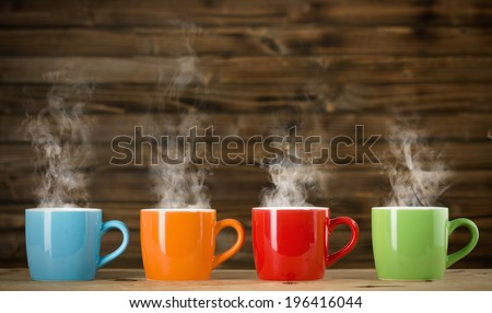 cups with steaming drinkthe cups with steaming drink - stock photo