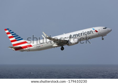 CURACAO - FEBRUARY 16: An American Airlines Boeing 737 taking off on February 16, 2014 in Curacao. American Airlines is the world's largest airline with 619 aircraft and 108 million passengers. - stock photo