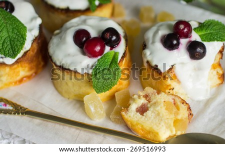 Curd pudding with candied fruit and fresh berries. Soft focus