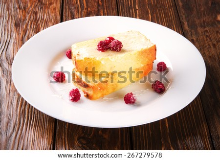 curd pudding with raspberries on a white plate - stock photo