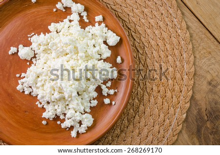 curds on the brown plate - stock photo