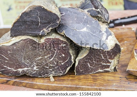Cured ham cut into food market, meat and meal - stock photo