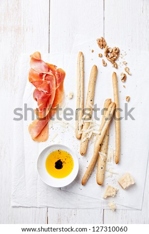 Cured Meat, Cheese and bread sticks - stock photo