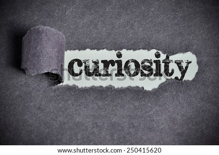 curiosity  word under torn black sugar paper  - stock photo