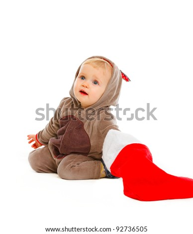 Curious adorable baby look what's inside of Santa sock