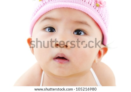 Curious Asian baby girl, isolated on white background - stock photo