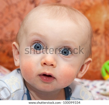 Curious Baby boy making surprised face - stock photo