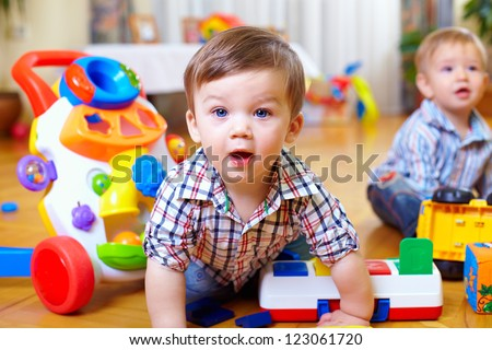 curious baby boy studying nursery room - stock photo