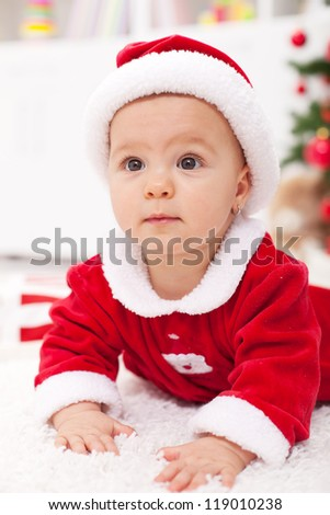 Curious baby girl in christmas outfit - closeup