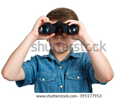 Curious  boy is looking through binoculars. Isolated on white background.