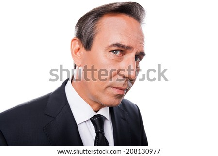 Curious businessman. Wide-angle image of mature man in formalwear looking at camera while standing isolated on white background