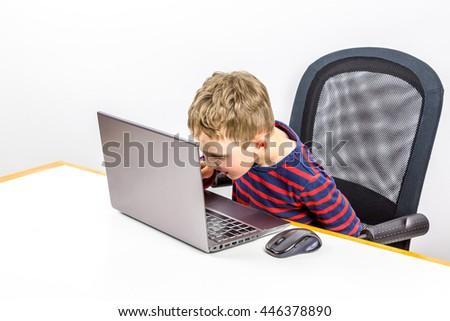 Curious Caucasian preschool boy using laptop, studio shot.  - stock photo