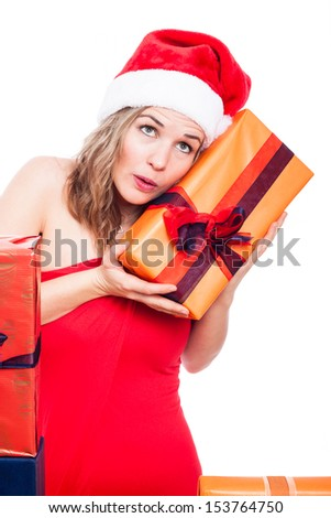Curious Christmas woman holding present, isolated on white background.
