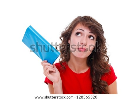 Curious girl with colorful book in hand, white background - stock photo