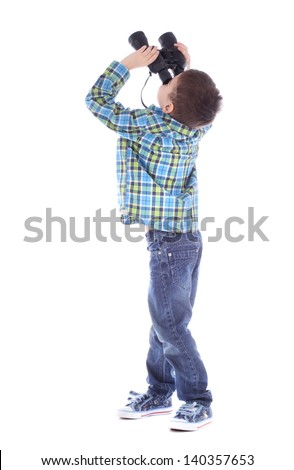 Curious little boy is looking left up through binoculars isolated over white background