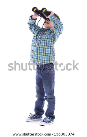 Curious little boy is looking through binoculars isolated over white background. - stock photo