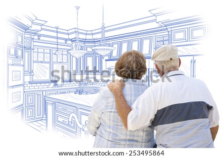 Curious Senior Couple Looking Over Blue Custom Kitchen Design Drawing. - stock photo