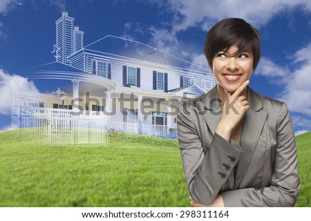 Curious, Smiling Mixed Race Woman Looks Over to Ghosted House Drawing, Partial Photo and Rolling Green Hills Behind. - stock photo