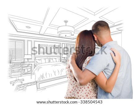 Curious Young Military Couple Looking Over Custom Bedroom Design Drawing.