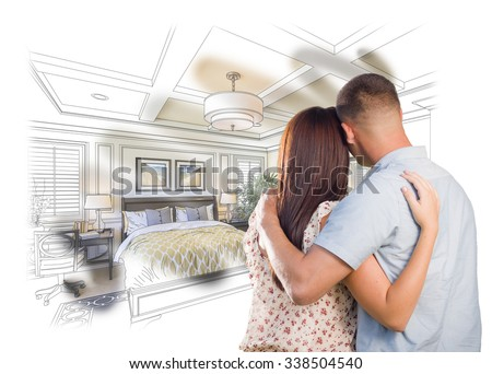 Curious Young Military Couple Looking Over Custom Bedroom Design Drawing Photo Combination. The framed art is photographer's copyright. - stock photo