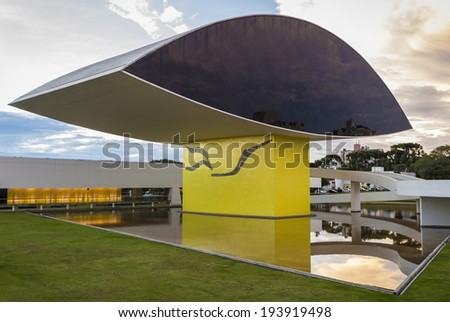 CURITIBA, BRAZIL APRIL 12: The Oscar Niemeyer Museum in Curitiba, Parana, Brazil with its eye-shapped monument placed in front of the main building is a landmark Parana photographed on April 12, 2014. - stock photo