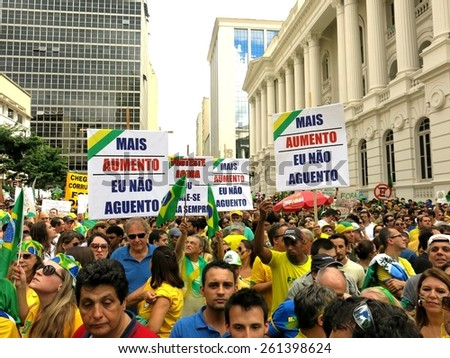 CURITIBA, BRAZIL - MARCH 15, 2015: 80,000 brazilians take the streets of Curitiba to protest against widespread government corruption and demand impeachment of the brazilian president Dilma Rousseff. - stock photo