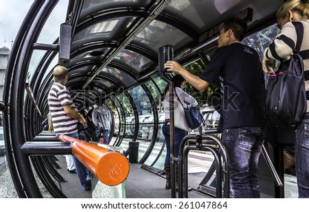 CURITIBA, BRAZIL - MARCH 30: Panoramic view of Curitiba in Parana, Brazil showcasing the architecture of its tube-shaped bus stops which are landmarks of the city with locals using it on March 30 2014 - stock photo