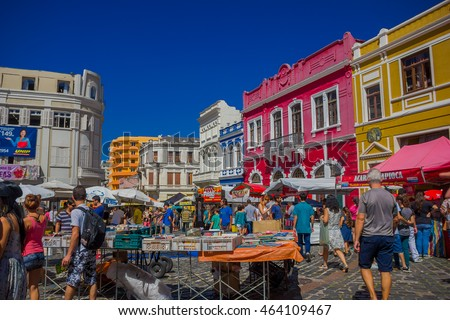 CURITIBA ,BRAZIL - MAY 12, 2016: people walking arround and visiting some stands at the market place, nice colorfull houses as background