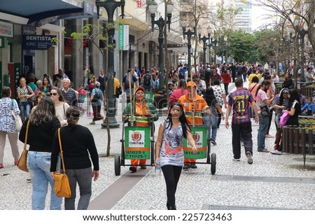 CURITIBA, BRAZIL - OCTOBER 7, 2014: People shop in pedestrian zone of Curitiba, Brazil. Curitiba is the 8th most populous city of Brazil with 1.76 million inhabitants.