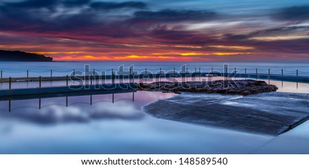 Curl Curl rock pool at sunrise - stock photo