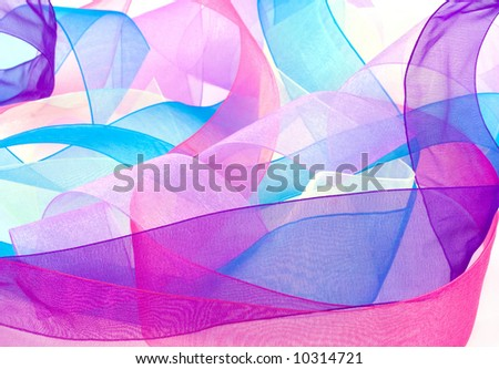 Curled and multicolored organza ribbons mingle in this bright background. - stock photo