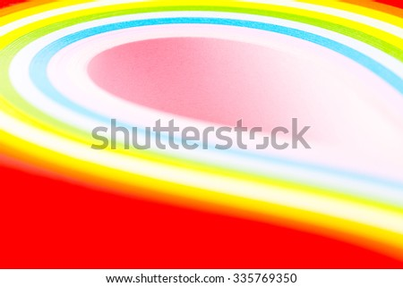 curled in a roll, twisted colored paper ribbon like a rainbow. Macro lens closeup shot 1:1 - stock photo