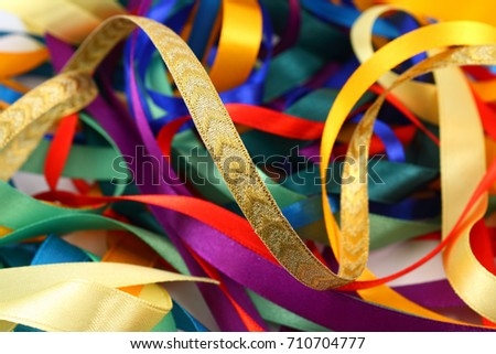 Curled ribbons of different colors and texture, close-up